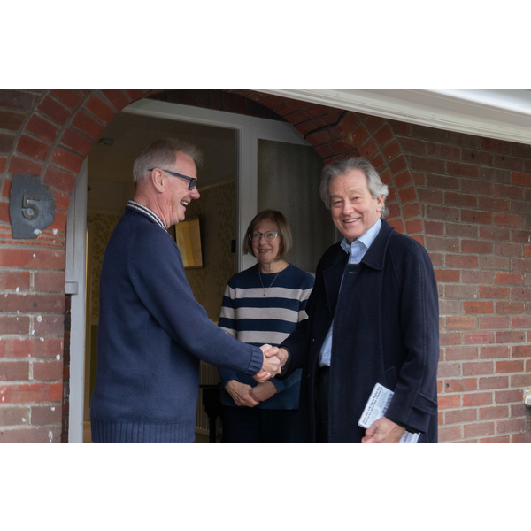 SD canvassing, shaking hands